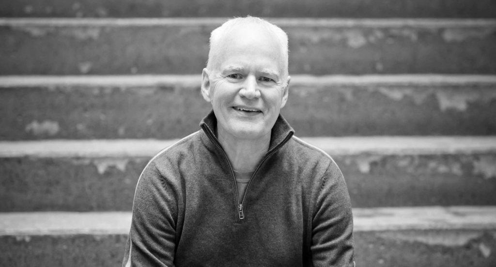 AJB Johnston on stairs, black and white photo